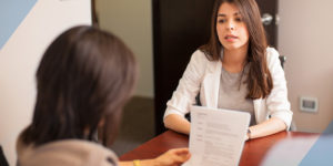 Lawyer consulting woman on legal help at a table in a law firm
